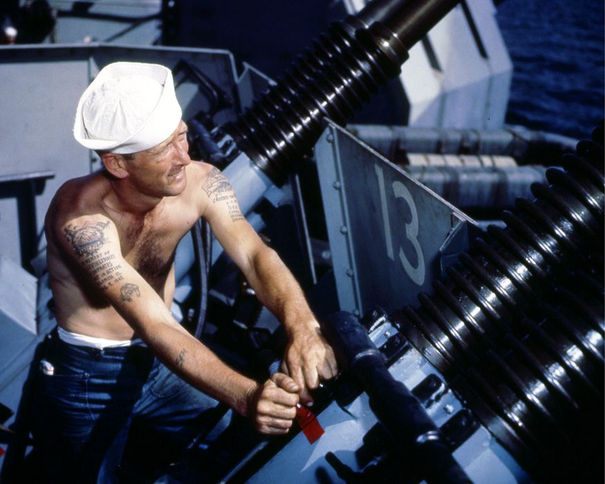 Gunner's Mate Second Class Charles J. Hansen works on 40mm quad anti-aircraft gun mount during the shakedown cruise of the Iowa-class battleship USS Missouri, mid to late 1944. (Photo by PhotoQuest/Getty Images)